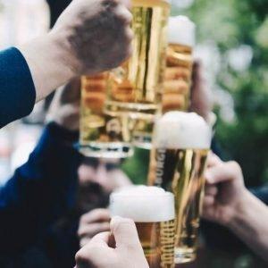 large beers toasting