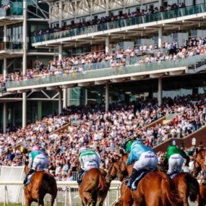 horses racing near cheering crowd